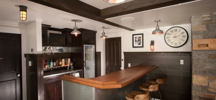 Calico Corners for a Rustic Wine Cellar with a Wood Bar Stools and Lake George Retreat by Phinney Design Group