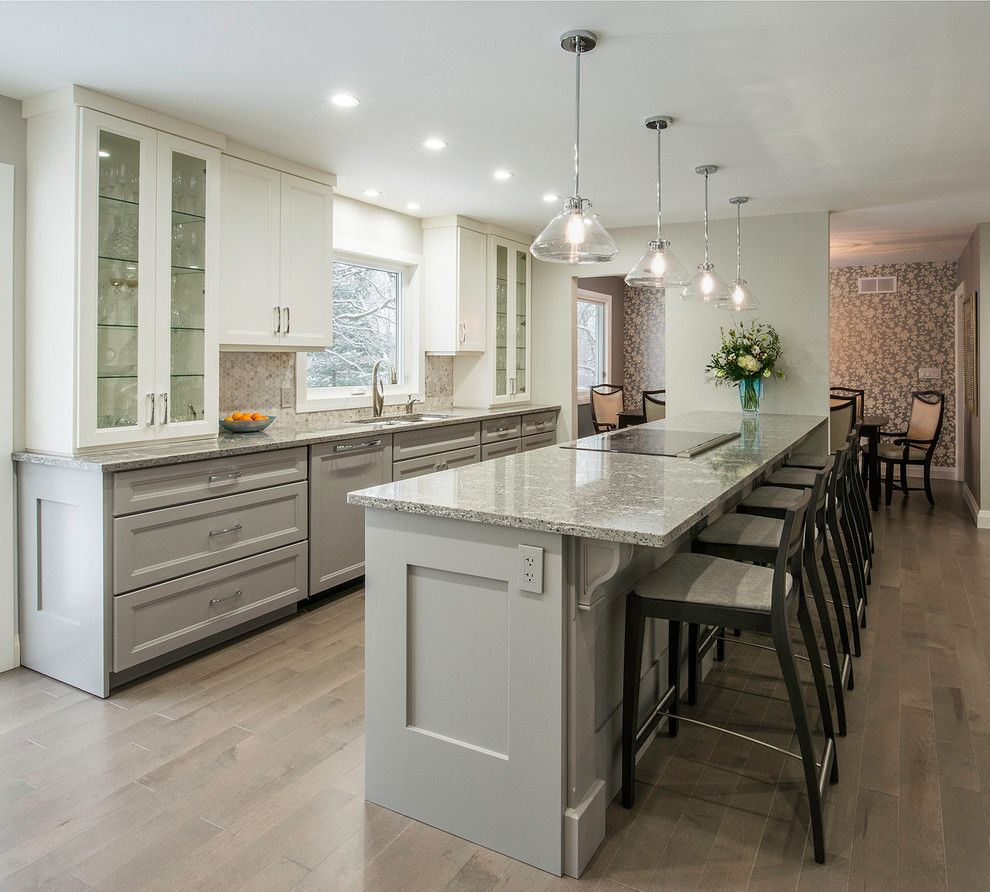 Cambria Countertops for a Transitional Kitchen with a Recessed Lighting and View of Peninsula by Tobi Brockway Interiors Inc.