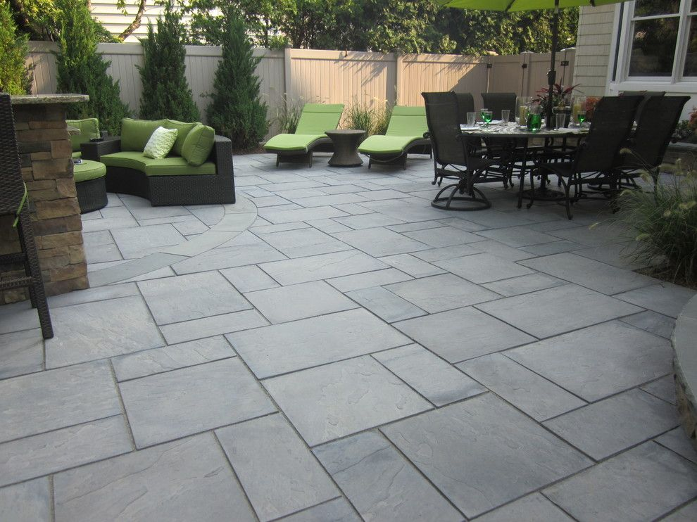 Cambridge pavers for a contemporary patio with a perennial for Green pavers