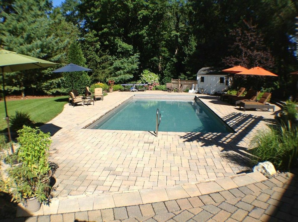 Cambridge Pavers for a Contemporary Patio with a Vinyl Pool and Cambridge Pavers by Deck and Patio Company