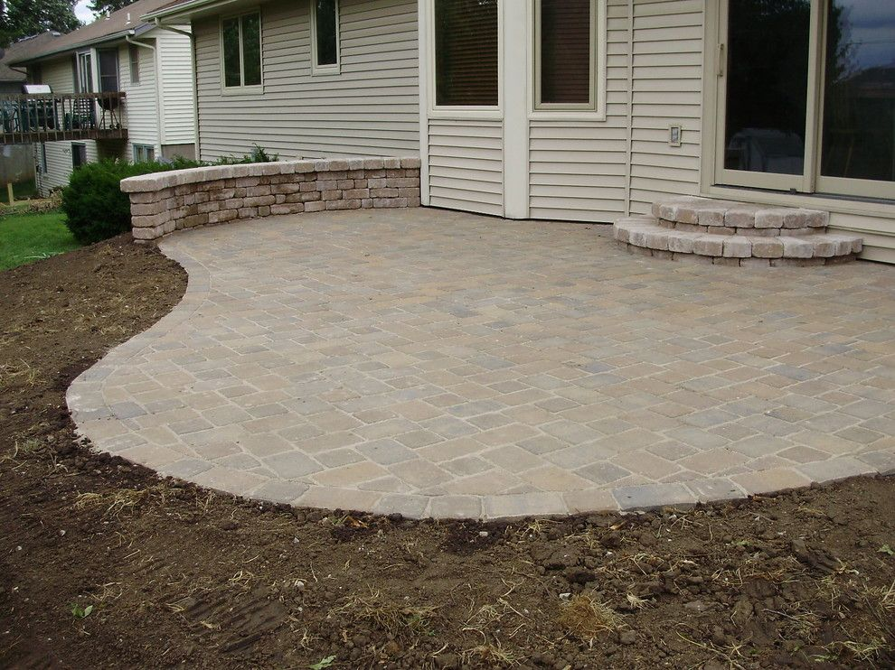 Cambridge Pavers for a  Landscape with a Patio and Cambridge Cobble Paver Patio by Topeka Landscape Inc