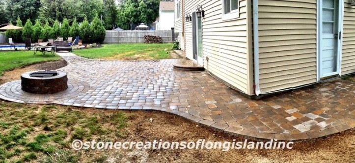 Cambridge Pavers for a Traditional Patio with a Landscape Lighting and Cambridge Paver Pool Patio with Firepit, East Northport, N.Y 11731 by Stone Creations of Long Island Pavers & Masonry