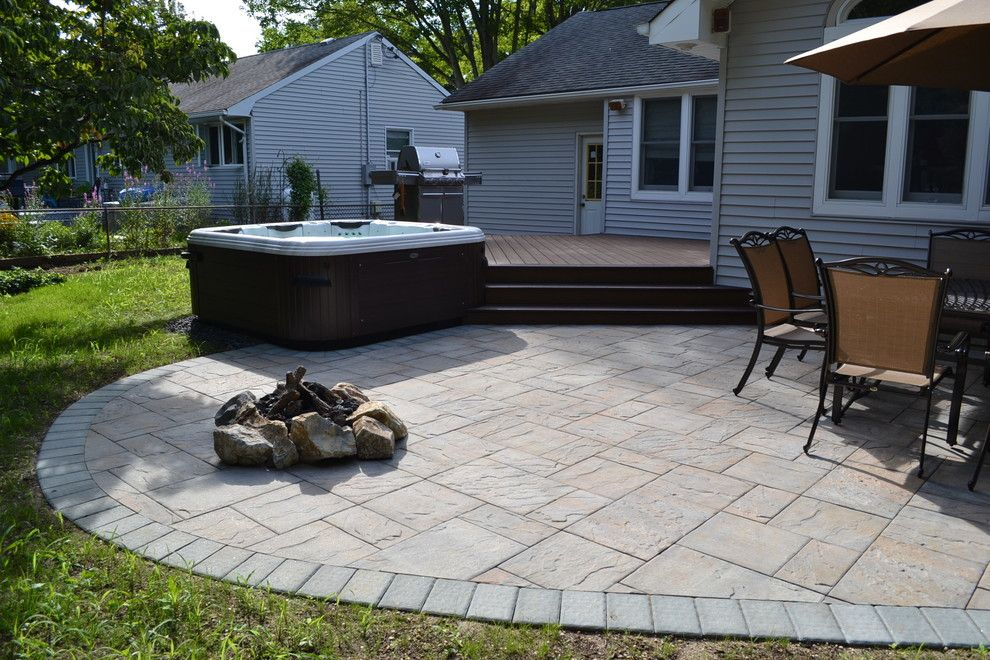 Cambridge Pavers for a Traditional Patio with a Swimming Pools and Hot Tub Bullfrog Spas with Trex Deck and Cambridge Paver Patio by Best Hot Tubs