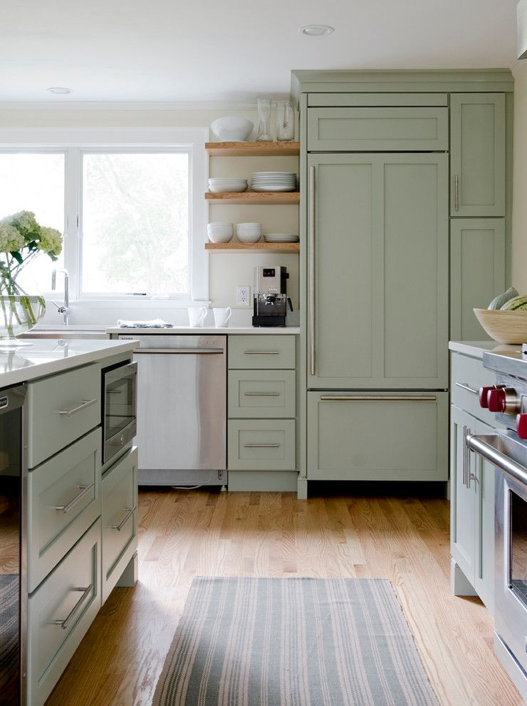 Candlelight Cabinetry for a Traditional Kitchen with a Microwave in the Island and Pond Cove by Kitchen Cove Cabinetry & Design