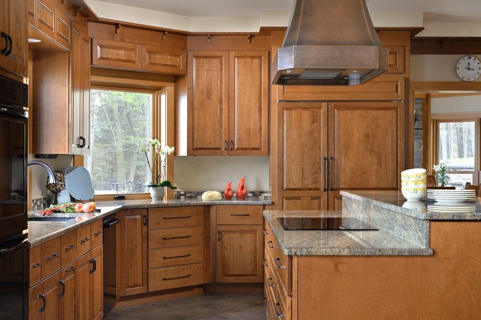 Candlelight Cabinetry for a Traditional Kitchen with a Wood Window Trim and Candlelight Cabinetry Portfolio by Candlelight Cabinetry, Inc