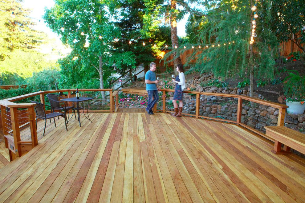 Cannon Pools for a Contemporary Deck with a Cable Railing and Wood, Naturally by Wood, Naturally