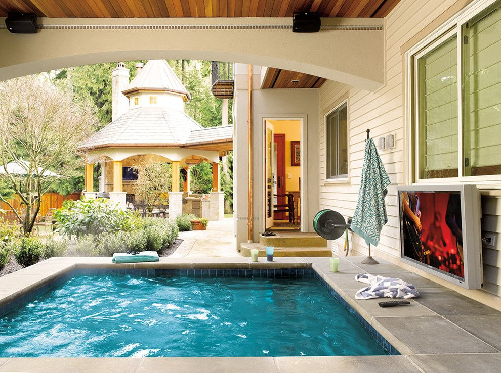 Cannon Pools for a Craftsman Pool with a Waterproof Tvs and Outdoor Spaces by Magnolia Design Center