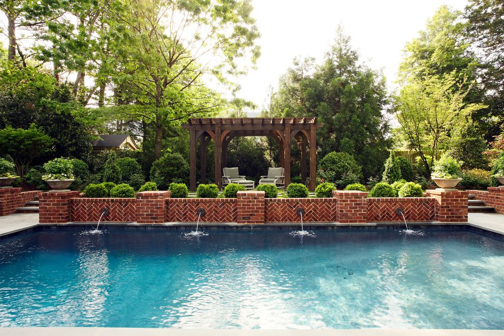 Cannon Pools for a Traditional Pool with a Low Brick Wall and 11609 by Tuckahoe Creek Construction, Inc.