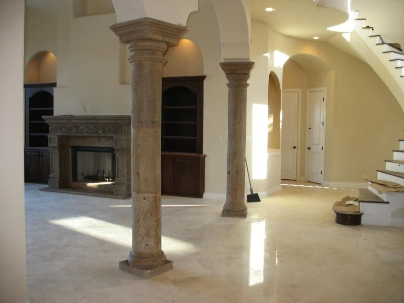 Cantera Stone for a  Living Room with a Stone Column and Columns by Cantera Stone Design, Llc
