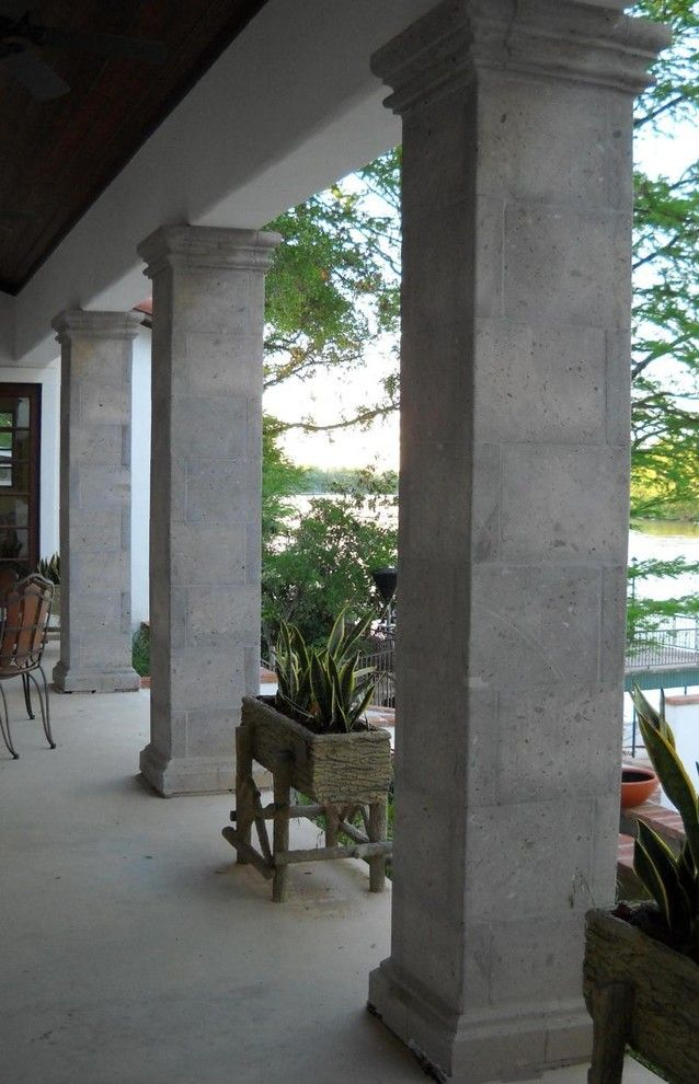 Cantera Stone for a  Porch with a Column Decor and Columns by Cantera Stone Design, Llc