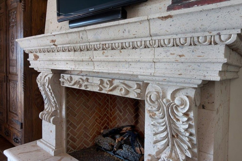 Cantera Stone for a Traditional Living Room with a Cabin Door and Cantera Stone Fireplace by Rustic Decor