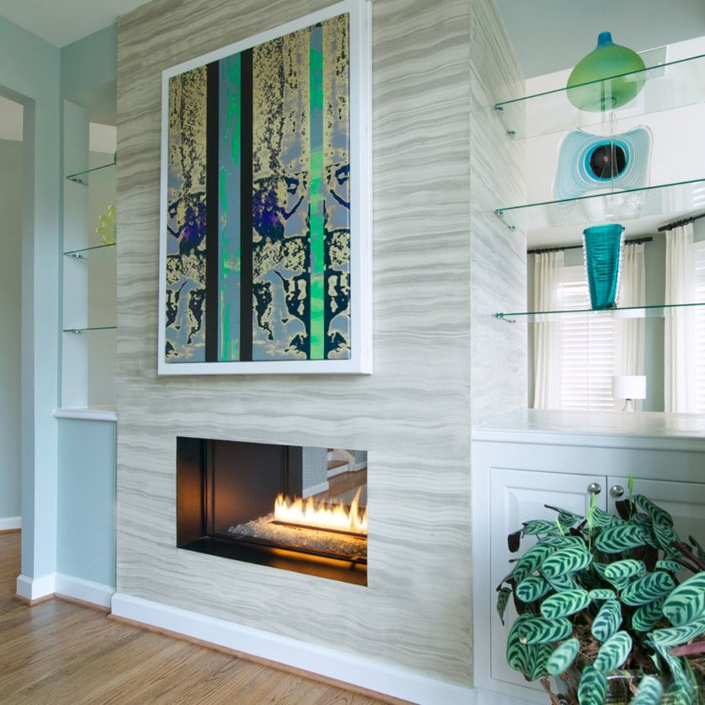 Canyon Creek Cabinets for a Modern Living Room with a Framed Art and Spark Modern Fires by Spark Modern Fires