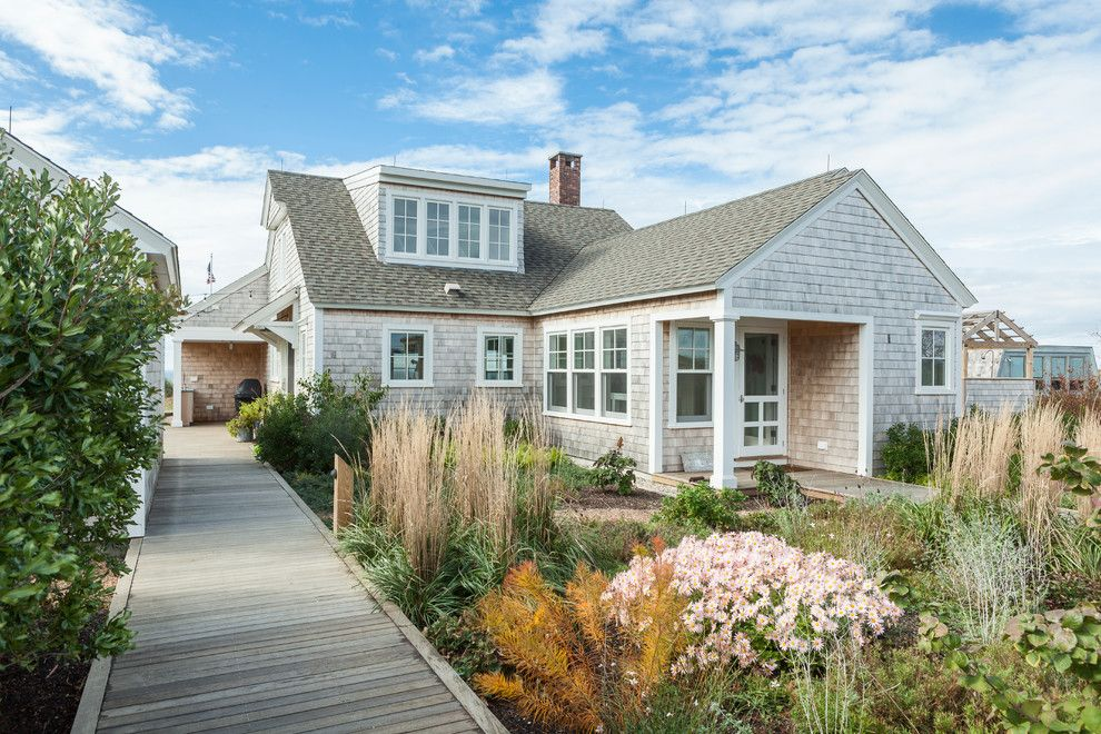 Cape Cod Lumber for a Beach Style Exterior with a Shingle Siding and Truro Cape Cod by Siberian Floors