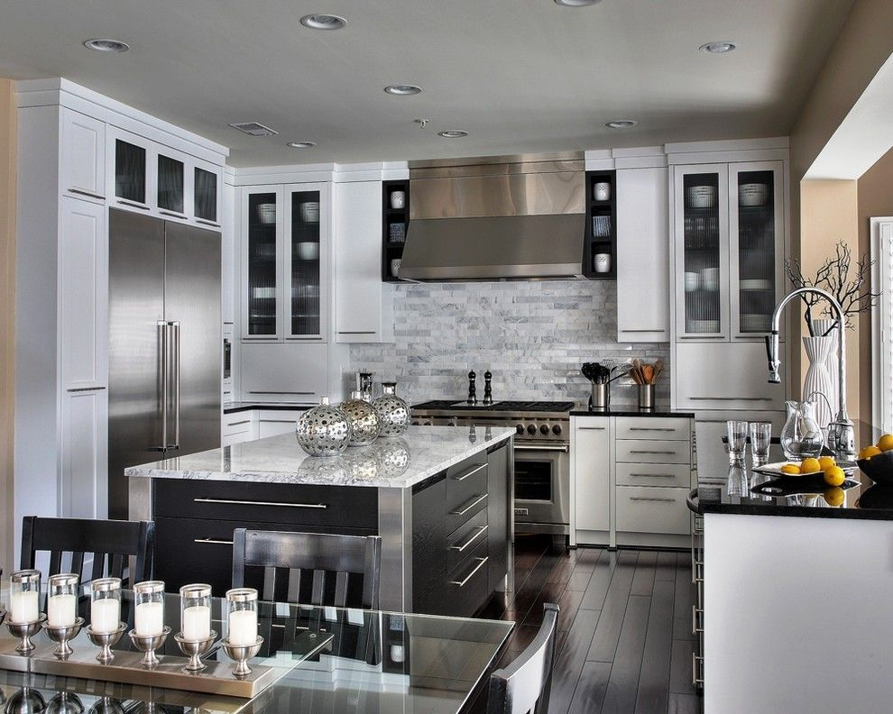 Carlisle Flooring for a Contemporary Kitchen with a Recessed Lights and Stunning White by Capitol Design, LLC