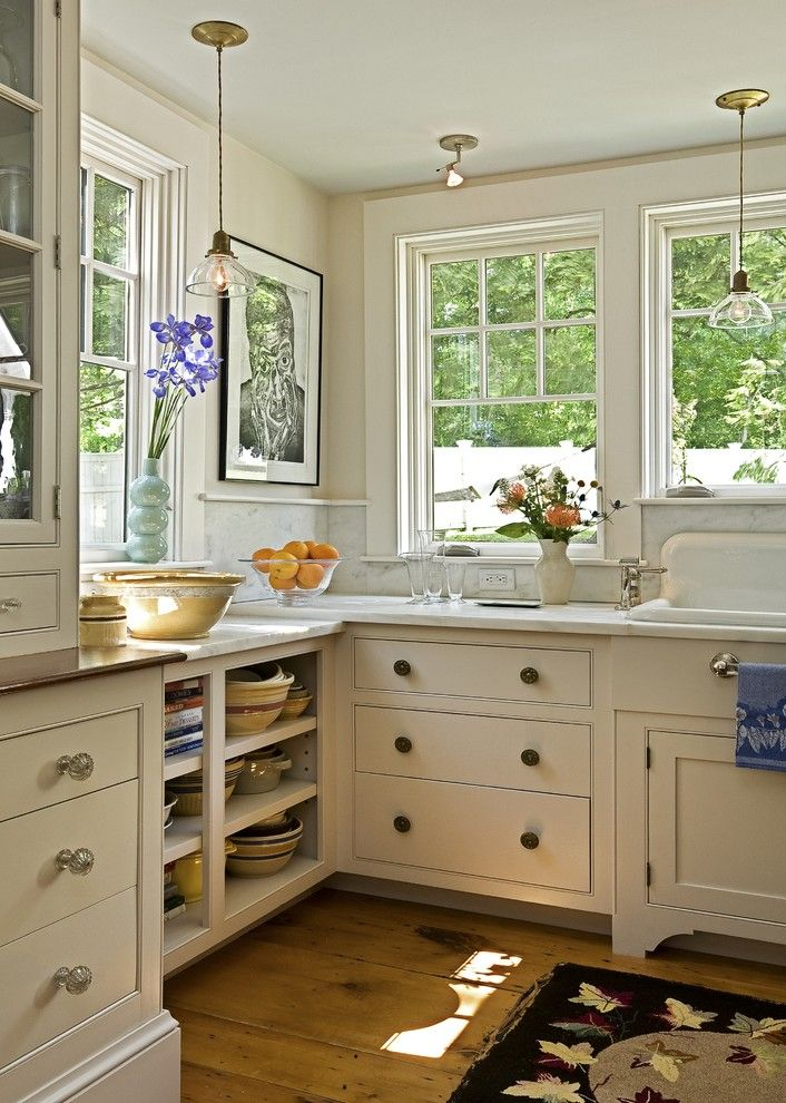 Carlisle Flooring for a Traditional Kitchen with a Farm Sink and Kitchen Transformation by Smith & Vansant Architects Pc