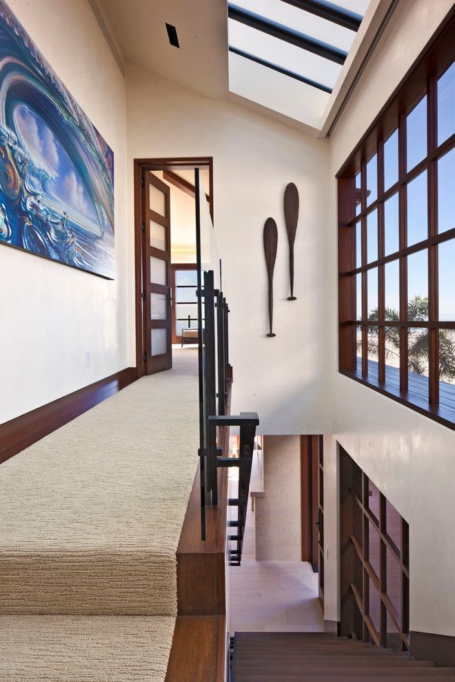 Carpeted Stairs for a Contemporary Staircase with a Large Windows and Newport Ocean Front by Jeremy Harnish Designer Finishes