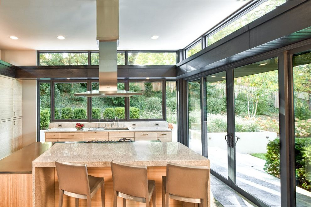 Caruso Homes for a Contemporary Kitchen with a Waterfall Countertop and Marvin Windows and Doors by Marvin Windows and Doors