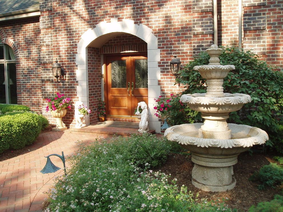 Carved Creations for a Traditional Landscape with a Brick Exterior and Granite Garden Fountain by Carved Stone Creations, Inc.