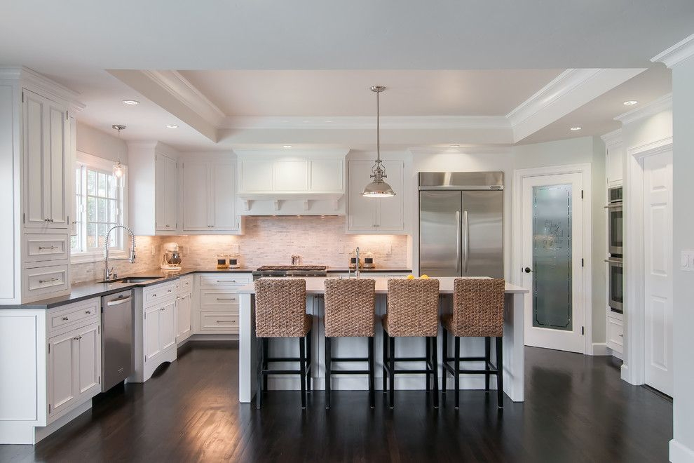 Ceaser Stone for a Transitional Kitchen with a Cove Lighting and Painted White Inset by Lazy Suzan Designs