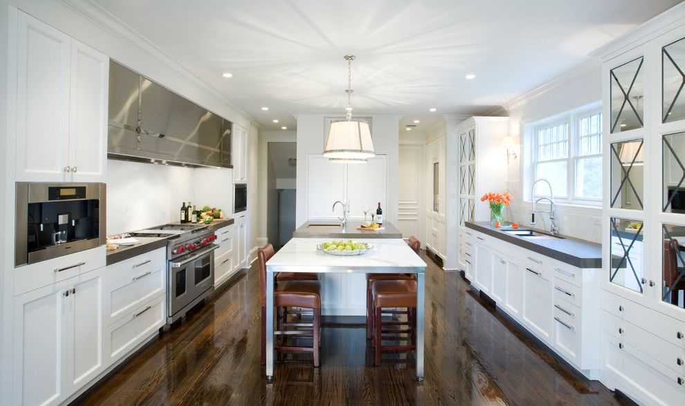 Ceaserstone for a Contemporary Kitchen with a Dark Wood Flooring and Mandeville, La by Trio Kitchen Design