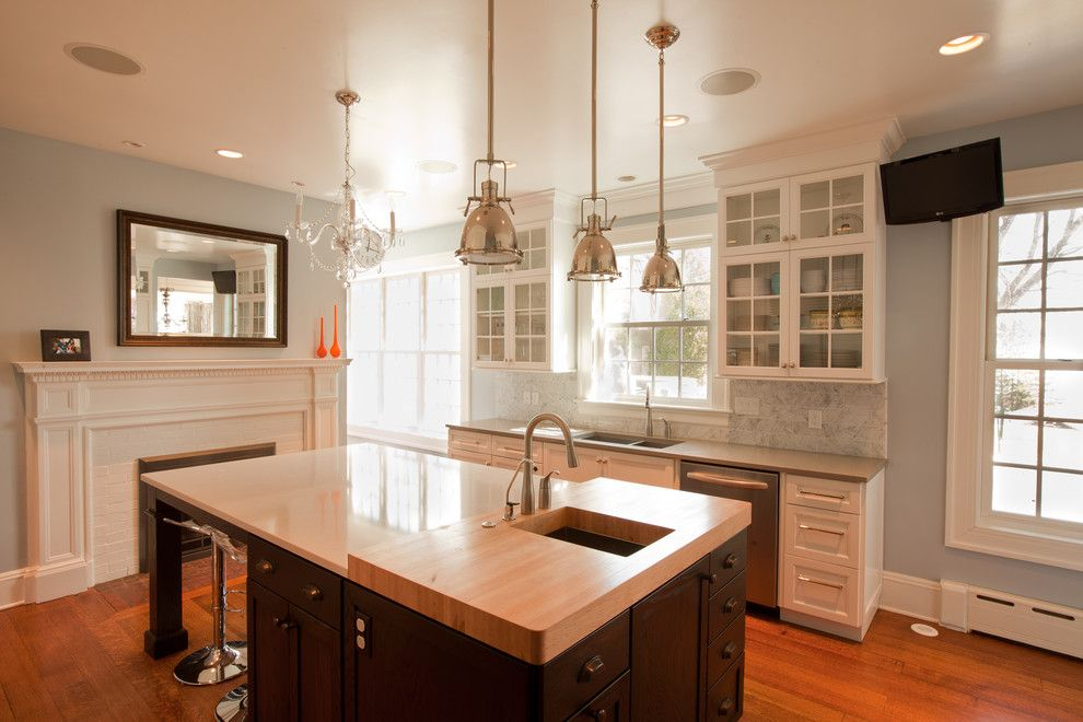 Ceaserstone for a Traditional Kitchen with a Fireplace and Transitional Glam Kitchen by Normandy Remodeling