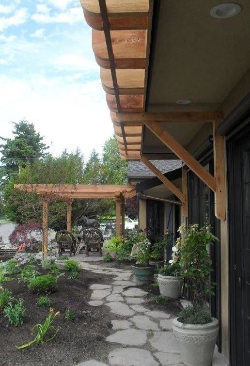 Cedar Creek Lumber for a  Porch with a Patio and Hillman/Pharaoh's Pergola by Cedar Creek Lumber