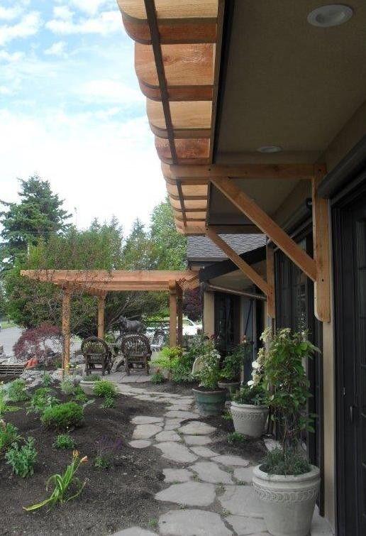 Cedar Creek Lumber for a  Porch with a Patio and Hillman/Pharaoh's Pergola by Cedar Creek Lumber