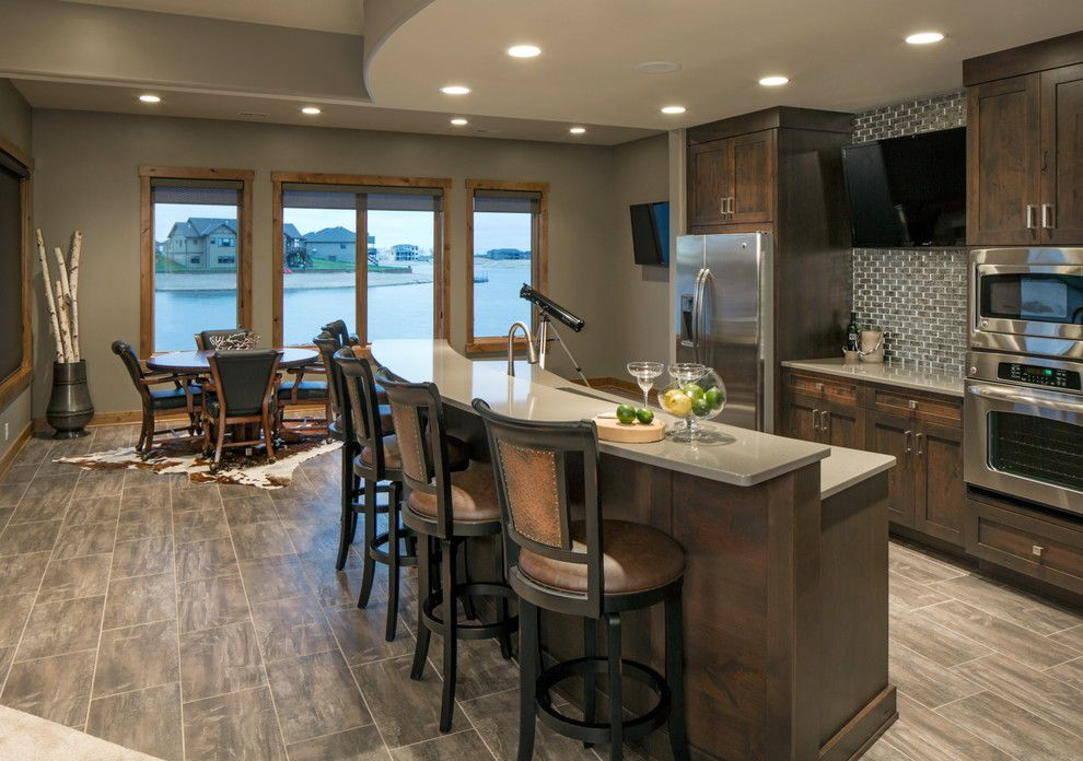 Celebrity Homes Omaha for a Transitional Basement with a Dark Stained Wood and Rustic Chic Lakehouse by Spaces Interiors/exteriors