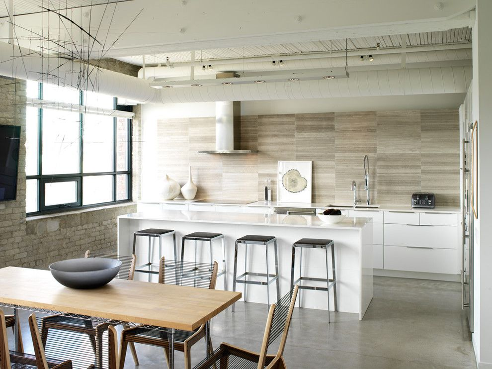 Cesar Stone for a Industrial Kitchen with a Minimal and Modern Loft Kitchen by Croma Design Inc