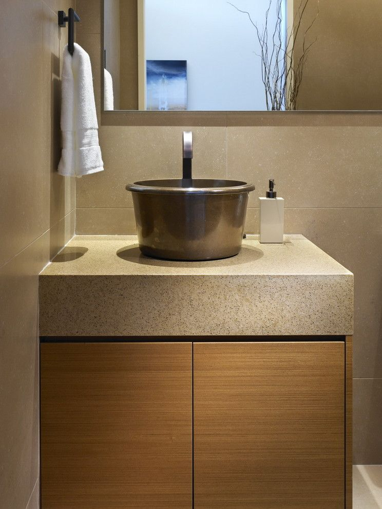 Cesarstone for a Contemporary Powder Room with a Wood Cabinets and While at Chil Design Group by Claudia Leccacorvi