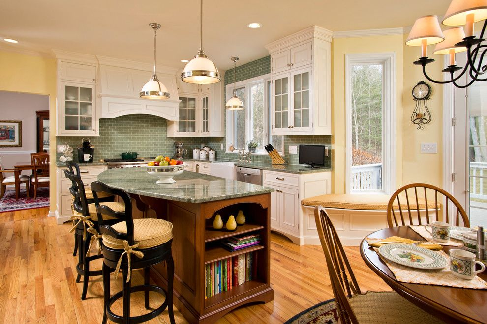 Chair Rail Height for a Traditional Kitchen with a Breakfast Bar and Spring Kitchen by Teakwood Builders, Inc.