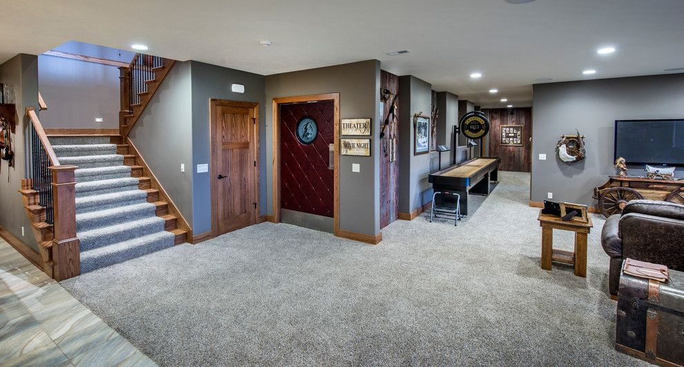 Charleston Homes Omaha for a Craftsman Basement with a Gray Stair Runner and Covered Bridge by Rezac Construction