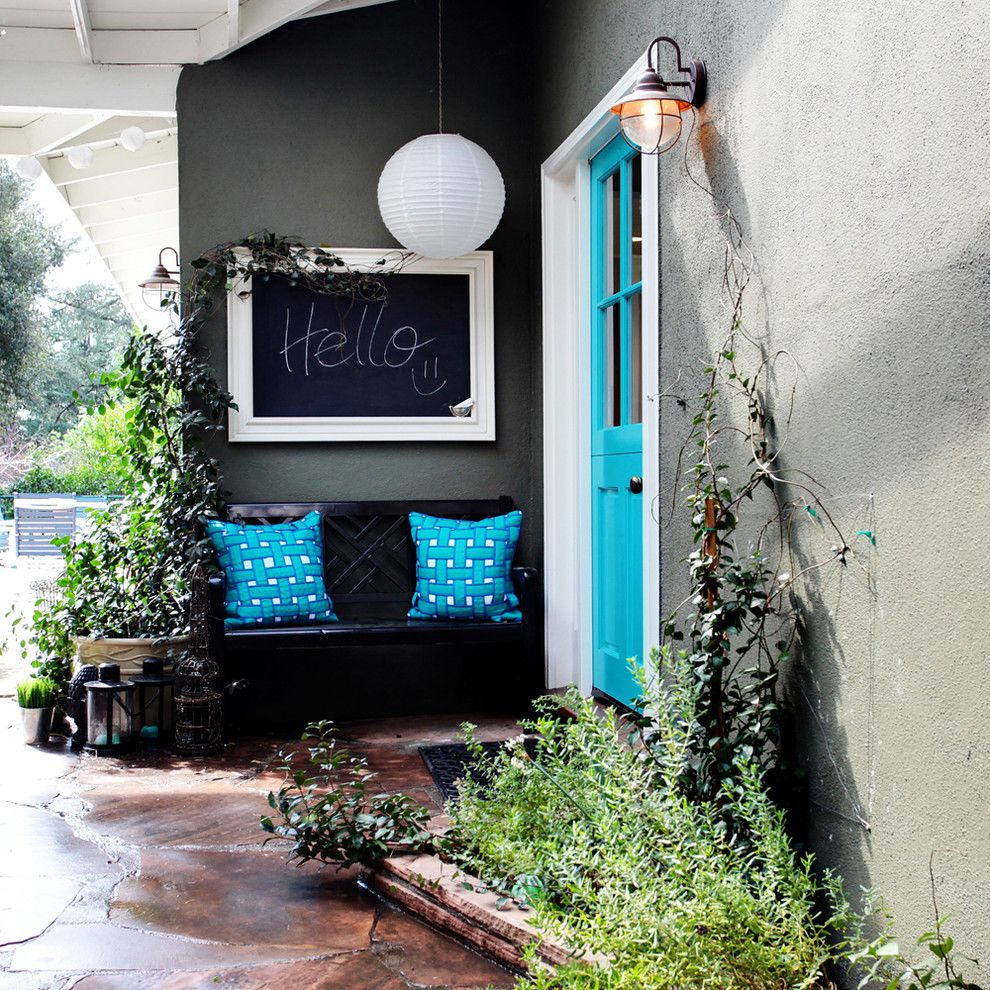 Chartreuse Color for a Eclectic Exterior with a Entry Bench and Colorful Cottage by Stephanie Wiley Photography