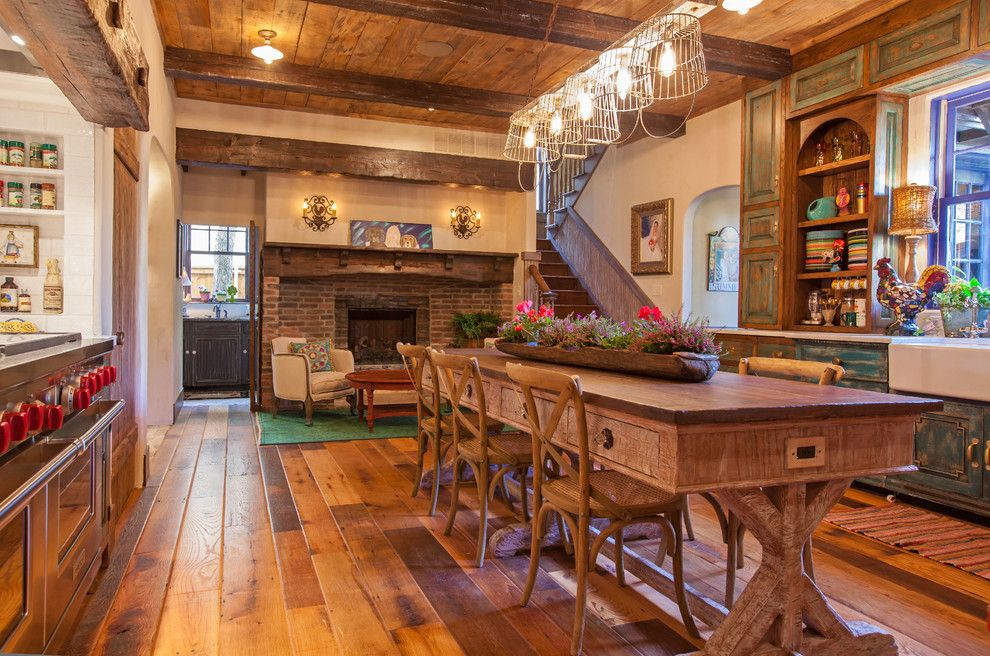 Chelsea Plank Flooring for a Farmhouse Kitchen with a Large Dining Table and Antique Barnboard Oak Flooring by Appalachian Woods
