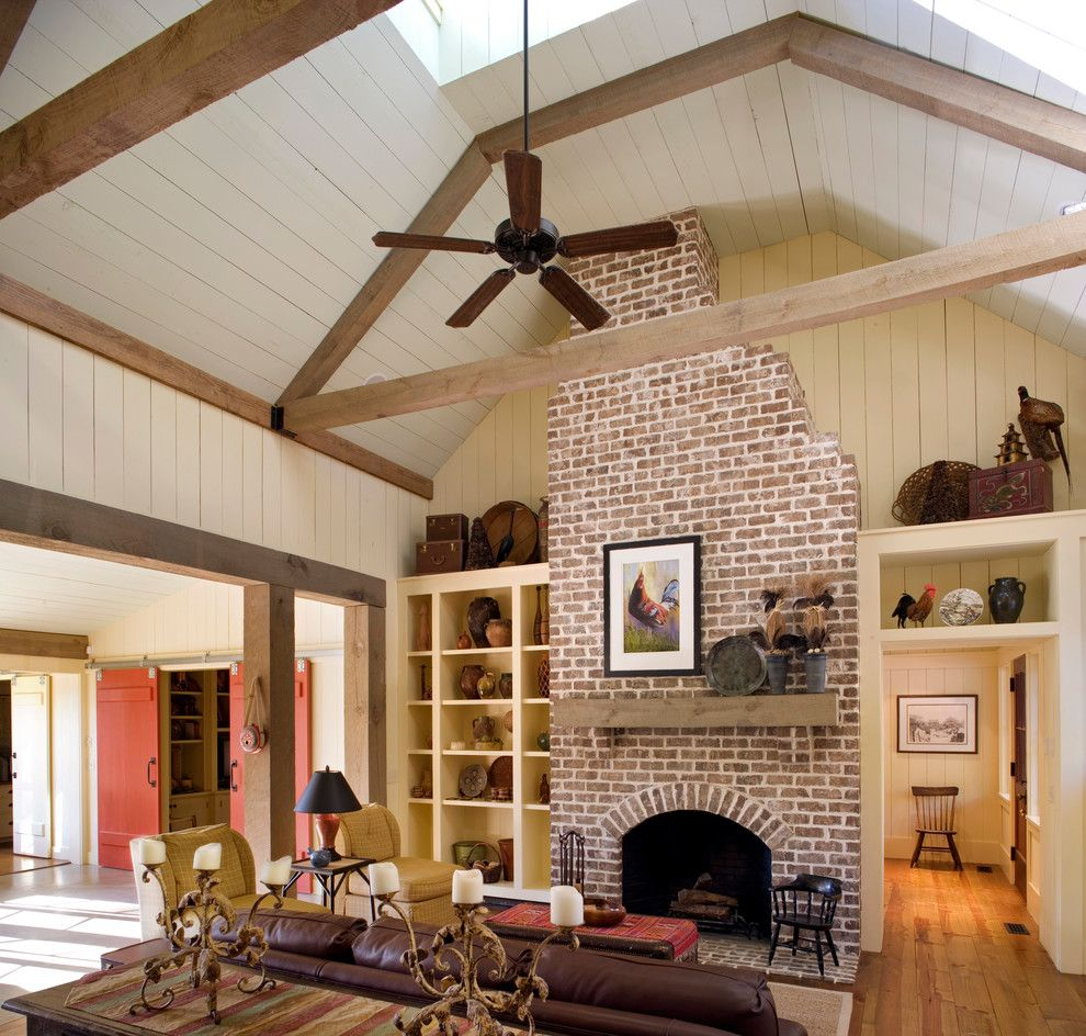 Cherokee Brick for a Rustic Family Room with a Vaulted Ceiling and Barn Retreat by Historical Concepts