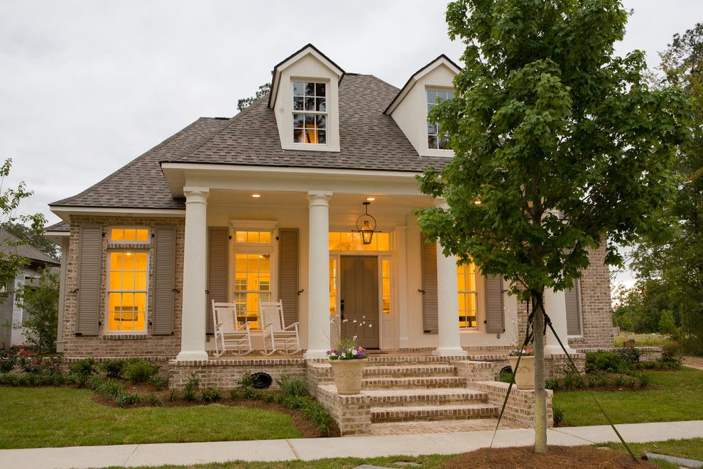 Cherokee Brick for a Traditional Exterior with a Beige Shutters and Traditional Front Porch by Highland Homes, Inc.