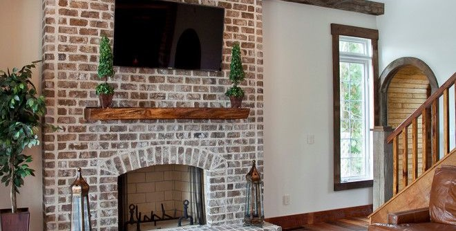 Cherokee Brick for a Traditional Living Room with a Brick Fireplace and Chateau De Charleston by Ink Architecture + Interiors