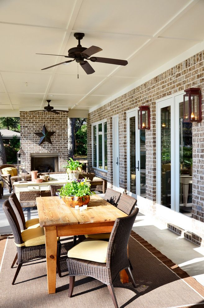 Cherokee Brick for a Traditional Patio with a Wood Dining Chair and Pensacola Waterfront by Sprague Construction