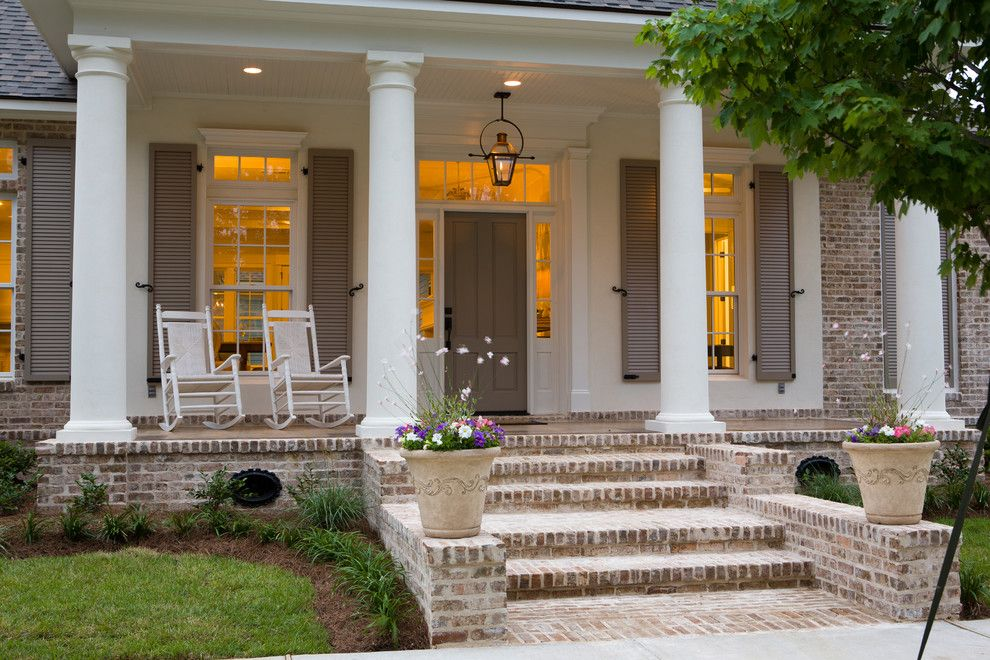 Cherokee Brick for a Traditional Porch with a White Posts and Traditional Front Porch by Highland Homes, Inc.
