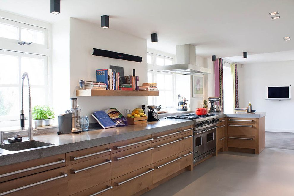 Chicago Faucet Shoppe for a Contemporary Kitchen with a Pulldown Faucet and My Houzz: Renovated Farmhouse Merges Historic and Modern Elements by Louise De Miranda
