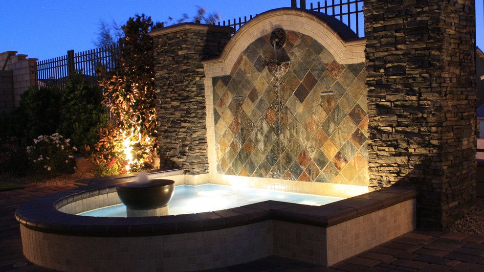 Chip N Dales for a Mediterranean Landscape with a Cultured Stone Veneer and Water Features by Chip N Dale's Custom Landscaping