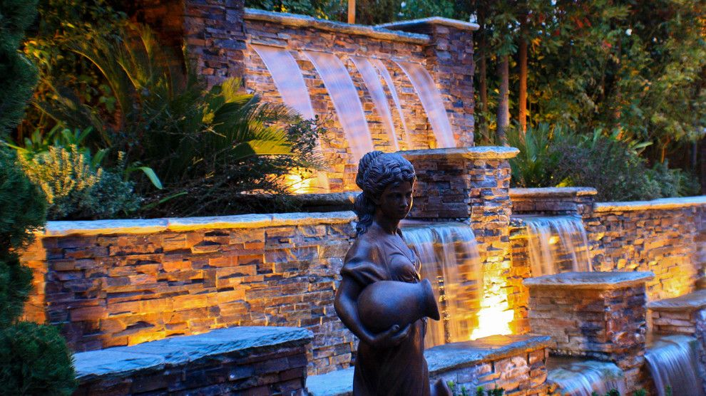 Chip N Dales for a Mediterranean Landscape with a Masonry and Statuary by Chip N Dale's Custom Landscaping