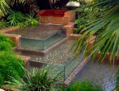 Chip N Dales for a Tropical Landscape with a Natural Stone and Water Features by CHIP-N-DALE'S CUSTOM LANDSCAPING