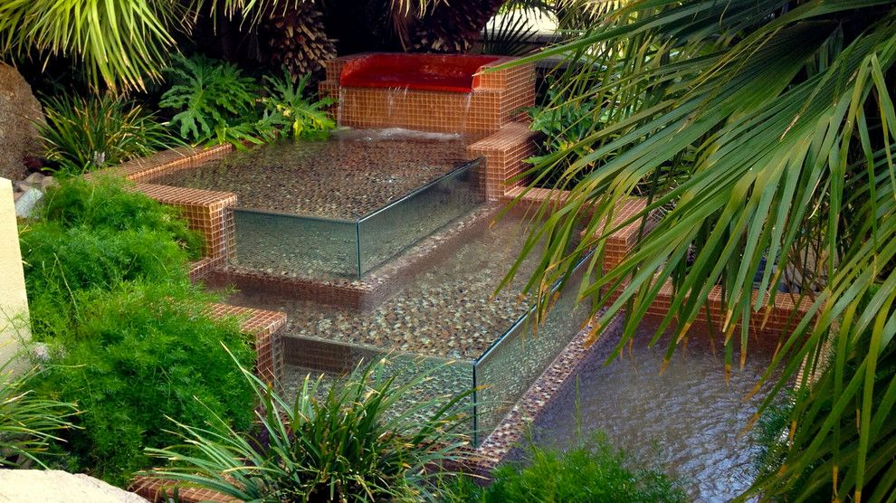 Chip N Dales for a Tropical Landscape with a Natural Stone and Water Features by Chip N Dale's Custom Landscaping