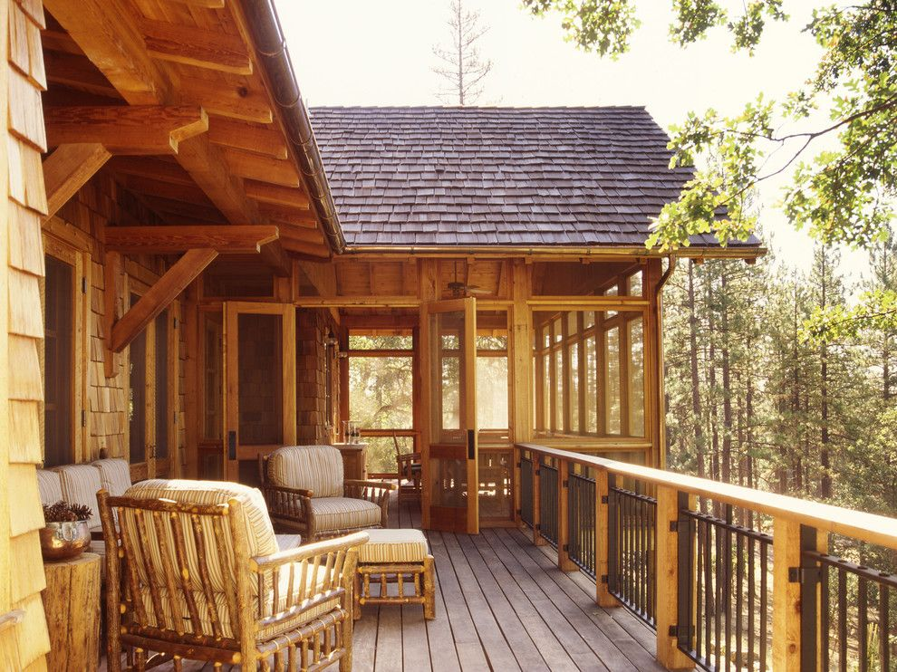 Chippewa Ranch Camp for a Rustic Deck with a Wood Railing and Family Ranch by Tucker & Marks