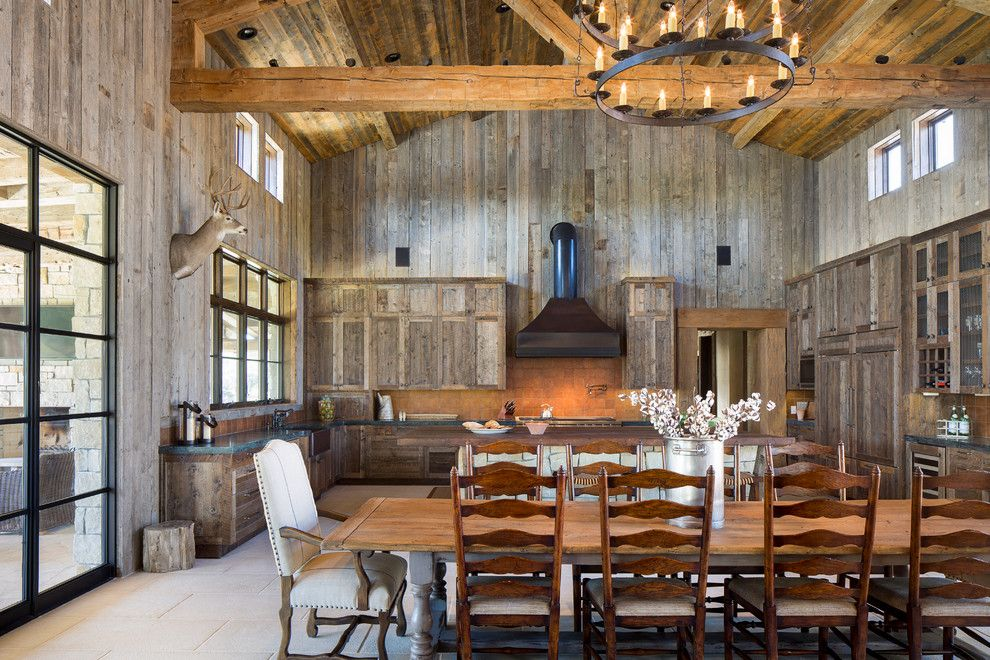 Chippewa Ranch Camp for a Rustic Dining Room with a Kitchen Island and Llano Ranch by Cornerstone Architects