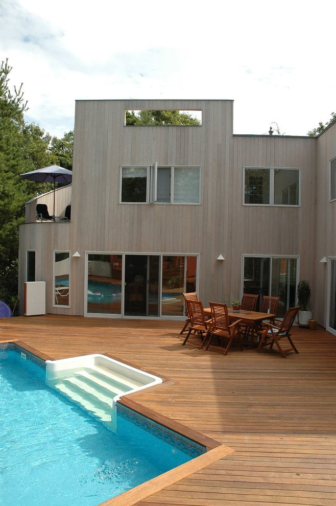 Claffey Pools for a Modern Pool with a Outdoor Dining and Wood, Naturally by Wood, Naturally