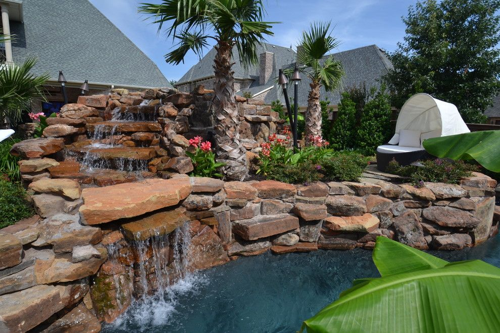 Claffey Pools for a Tropical Landscape with a Tropical Plants and Colleyville Residential Lazy River by Mike Farley Pool Designer
