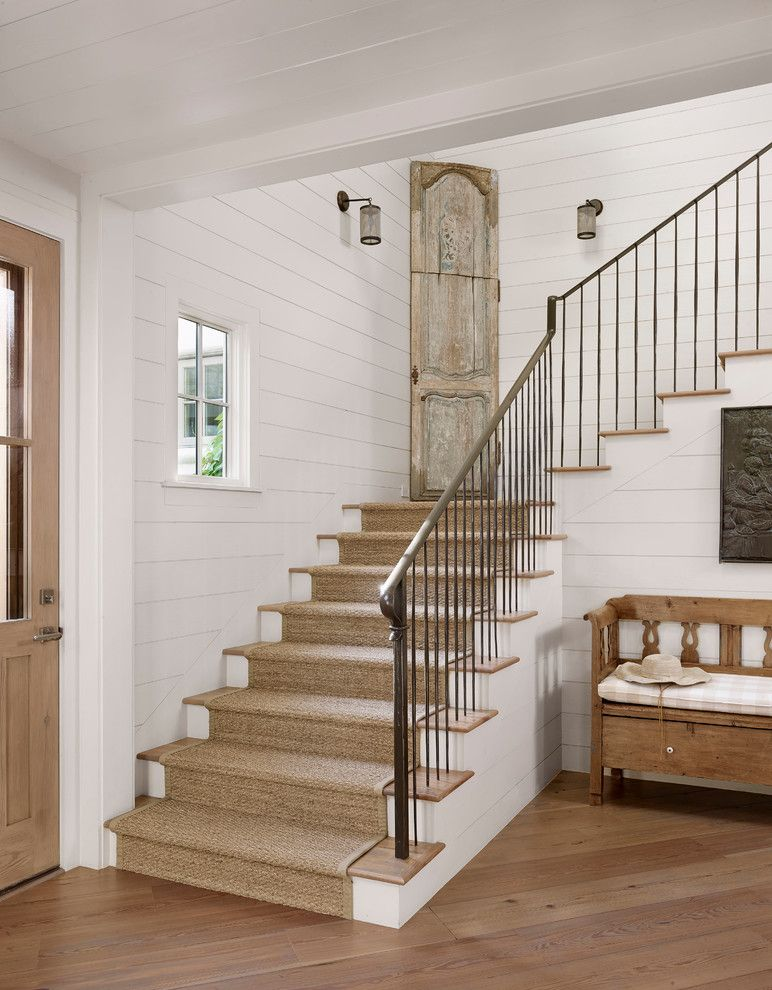 Clapboard for a Farmhouse Staircase with a Medium Wood Flooring and Stratford Mountain by Ryan Street & Associates
