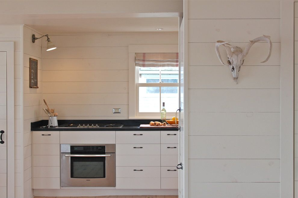 Clapboard for a Rustic Kitchen with a Antlers and Harbor Cottage, Maine by Justine Hand